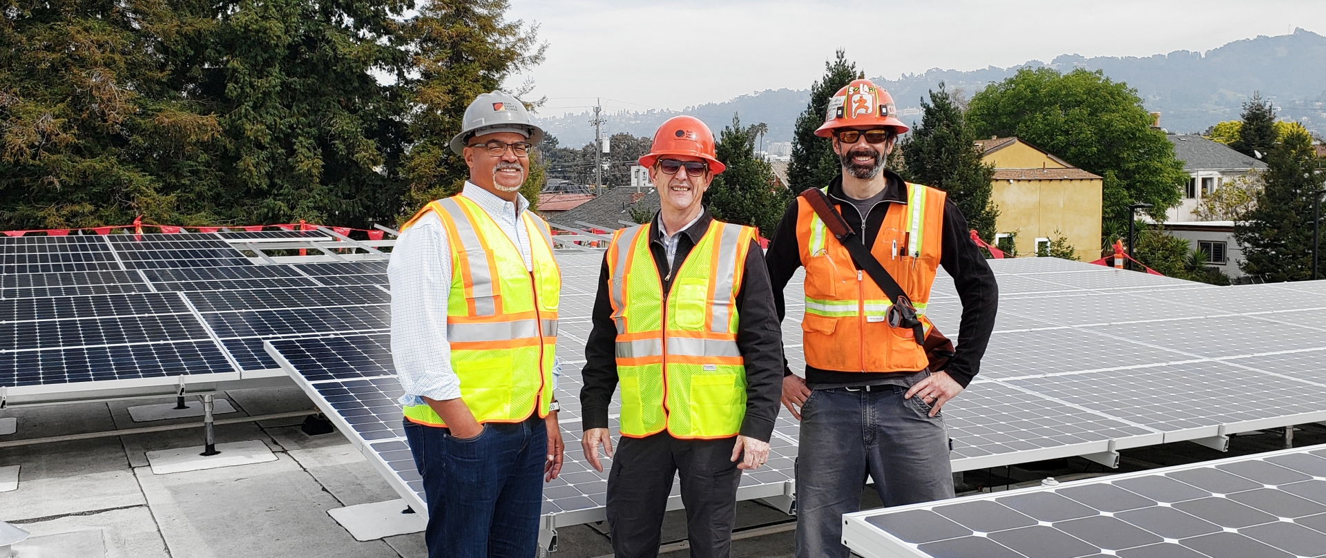 Harry, Gary and Blake standing in front of a Solar PV installation