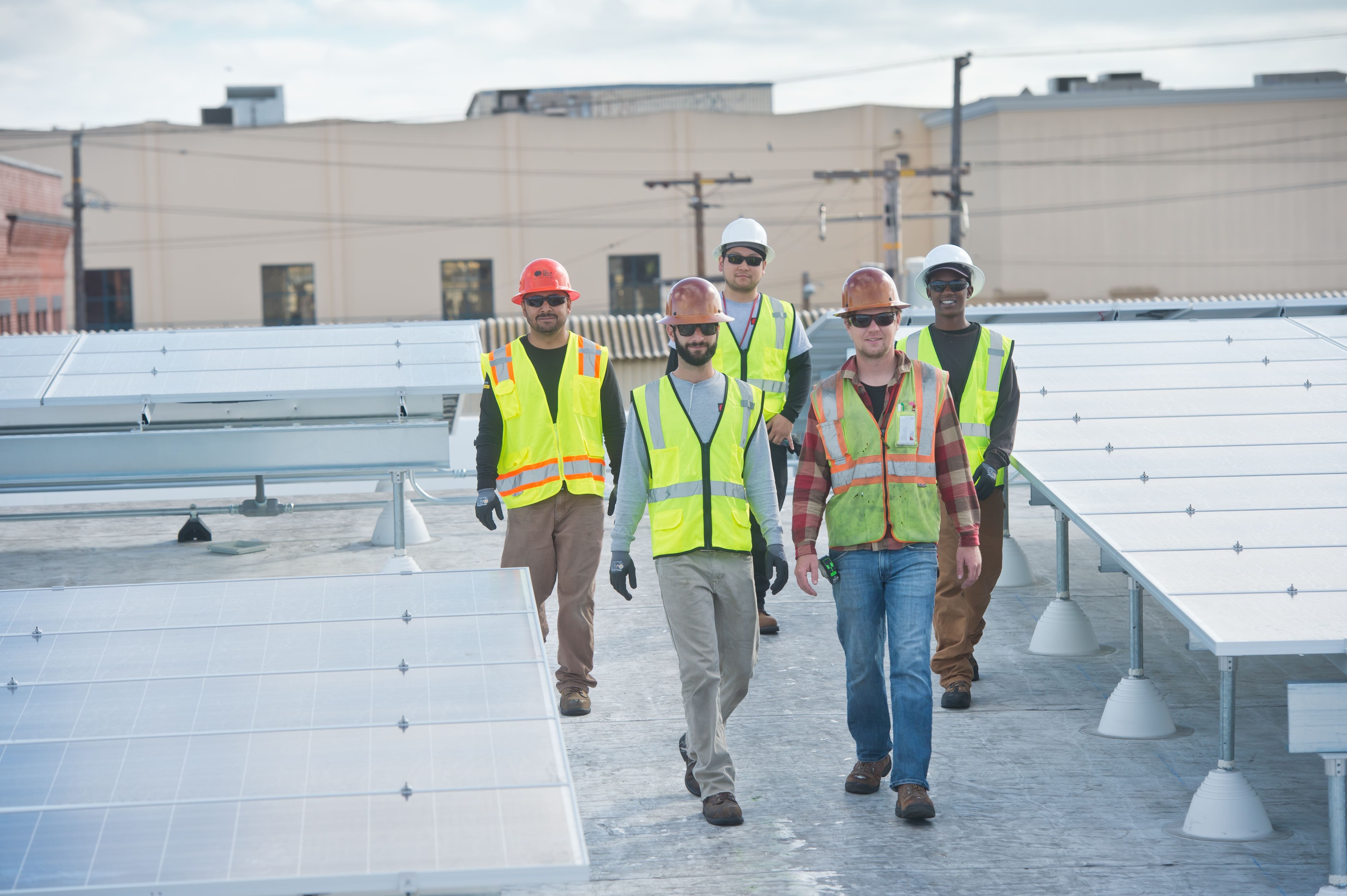 Sun Light & Power solar engineers on rooftop solar project